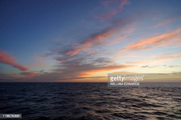 The sunrise over the the North Sea is pictured from aboard the Good Fellowship fishing trawler, while its nets trawl the sea bed for prawns and other...