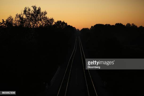 The sunrise reflects off Norfolk Southern Corp train tracks in Lawrenceburg Kentucky US on Tuesday Oct 17 2017 Norfolk Southern Corp is scheduled to...