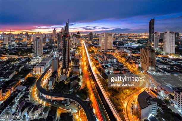 the sunrise view of bangkok in the business district of thailand - bangkok stock pictures, royalty-free photos & images