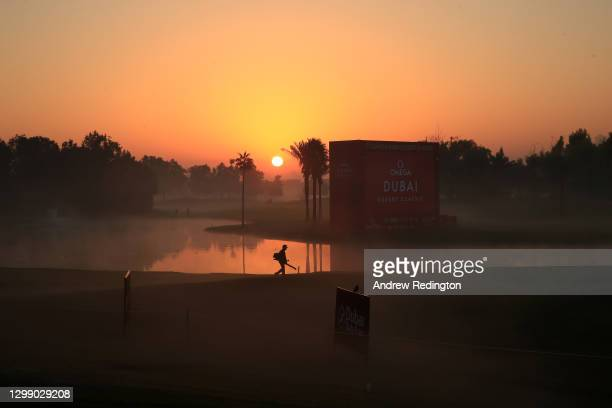 The sunrises over the course during Day One of the Omega Dubai Desert Classic at Emirates Golf Club on January 28, 2021 in Dubai, United Arab...