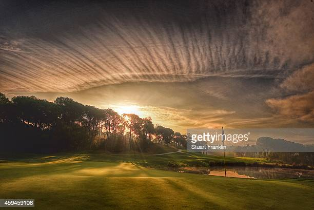 The sunrises over the fourth hole prior to the final round of the European Tour qualifying school final stage at PGA Catalunya Resort on November 20...