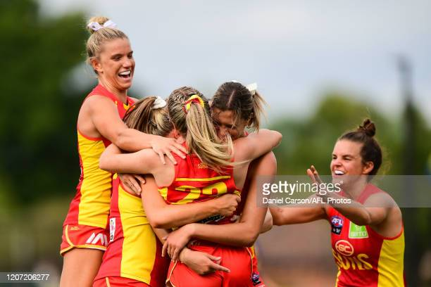 The Suns celebrate the win on the siren during the 2020 AFLW Round 06 match between the West Coast Eagles and the Gold Coast Suns at Mineral...