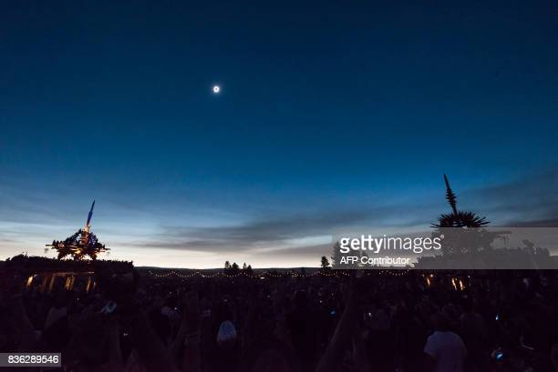 The sun's corona only is visible during a total solar eclipse between the Solar Temples at Big Summit Prairie ranch in Oregon's Ochoco National...