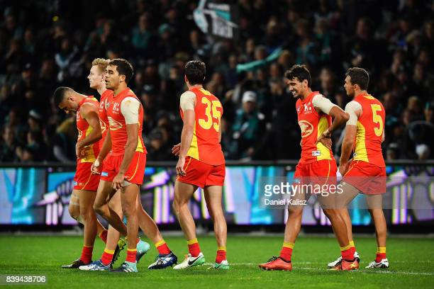 The Suns players look on dejected during the round 23 AFL match between the Port Adelaide Power and the Gold Coast Suns at Adelaide Oval on August 26...