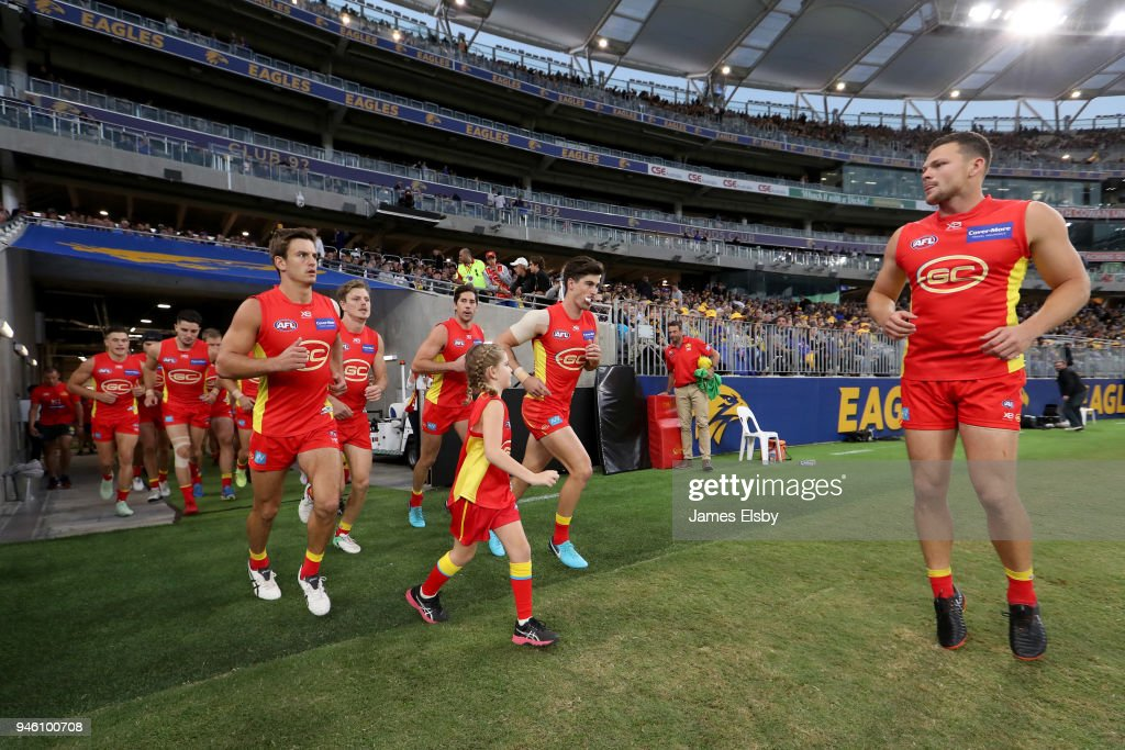 The Suns run out during the round four AFL match between the West Coast Eagles and the Gold Coast Suns at Optus Stadium on April 14, 2018 in Perth, Australia.