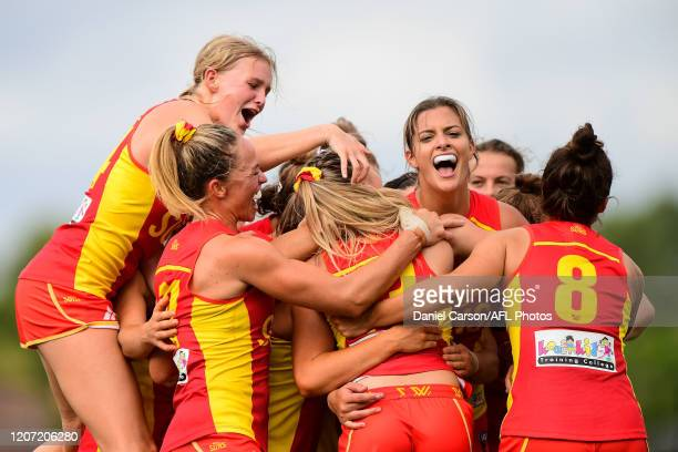 The Suns wrap around Lauren Bella and celebrate the win on the siren during the 2020 AFLW Round 06 match between the West Coast Eagles and the Gold...