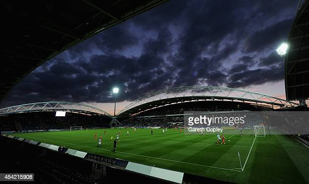 The sunset as first half play takes place during the Capital One Cup Second Round match between Huddersfield Town and Nottingham Forest at Galpharm...