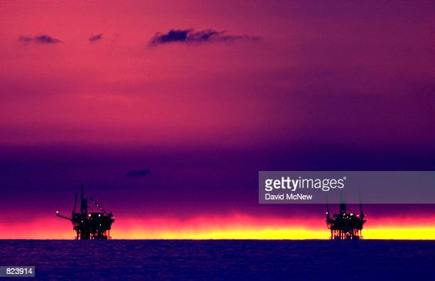 The sunset fades beyond the Hillhouse A left and Hillhouse B oil and gas platforms near the Federal Ecological Reserve in the Santa Barbara Channel...