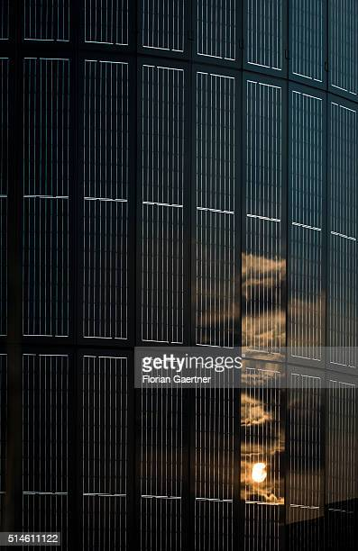 The sunset is reflected in a photovoltaics pylon on March 08 2016 in Berlin Germany