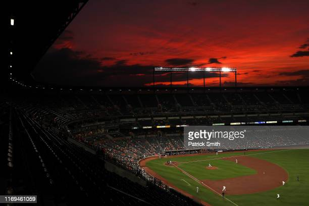 The sunset is seen in a general view as the Kansas City Royals play the Baltimore Orioles during the fourth inning at Oriole Park at Camden Yards on...