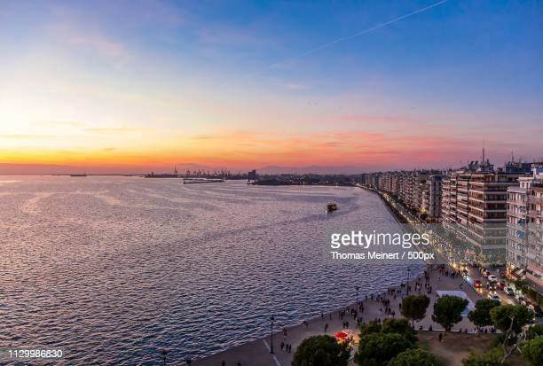 the sunset of thessaloniki - thessaloniki stock pictures, royalty-free photos & images