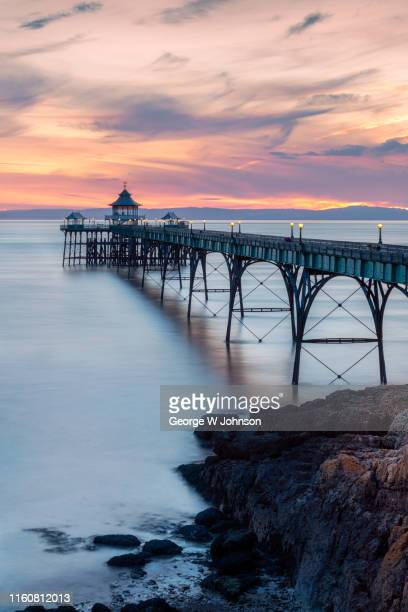 the sunset pier #2 - clevedon pier stock pictures, royalty-free photos & images