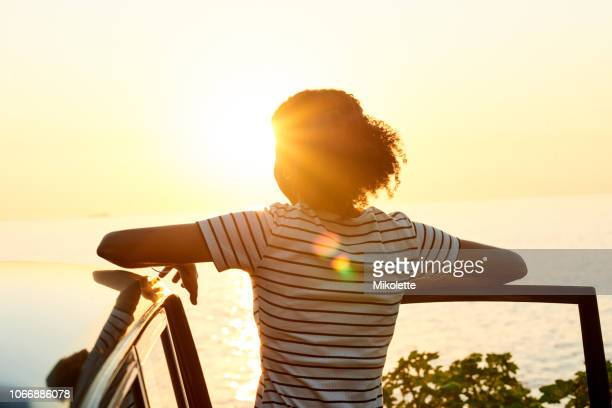 the sunset was the highlight of her trip - unrecognizable person stock pictures, royalty-free photos & images