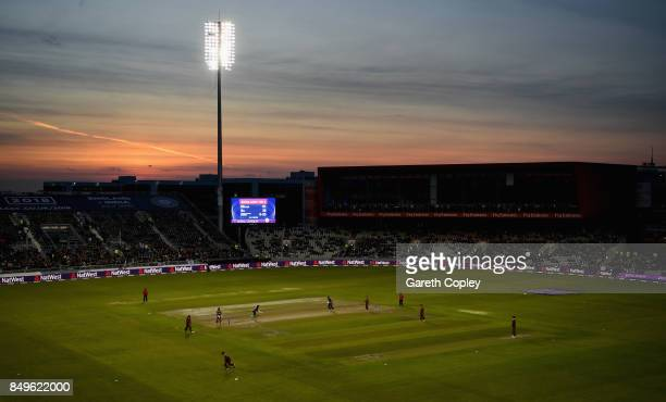 The sunsets as England bat during the 1st Royal London One Day International match between England and the West Indies at Old Trafford on September...