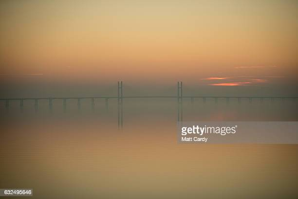 The sunsets behind the M4 Second Severn Crossing on January 23 2017 in Bristol England The two Severn crossings The M48 Severn Bridge and M4 Second...