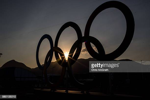 The sunsets behind the Olympic rings in Olympic Park ahead of the Rio 2016 Olympic Games on August 1 2016 in Rio de Janeiro Brazil The games commence...