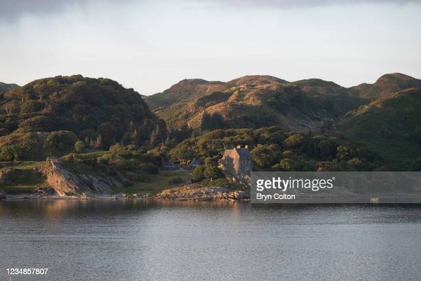 The sunsets on Duntrune Castle on the banks of Loch Crinan on August 19, 2021 in Crinan, Scotland. Passage along the canal has been reduced as water...