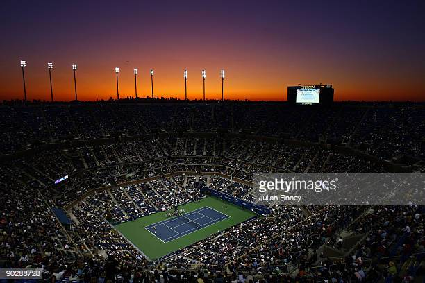 The sunsets over Arthur Ashe Stadium as Maria Sharapova of Russia takes on Tsvetana Pironkova of Bulgaria during day two of the 2009 U.S. Open at the...