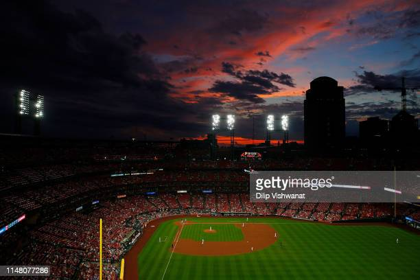 The sunsets over Busch Stadium during a game between the St Louis Cardinals and the Cincinnati Reds on June 4 2019 in St Louis Missouri