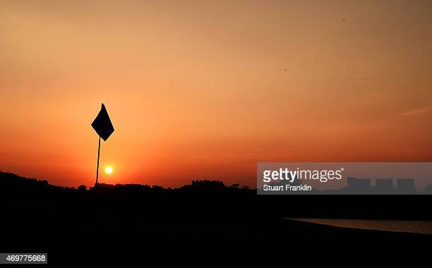 The sunsets over the 18th green prior to the start of the Shenzhen International at Genzon Golf Club on April 15 2015 in Shenzhen China