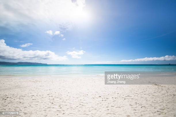 the sunshine beach in boracay - soleggiato foto e immagini stock