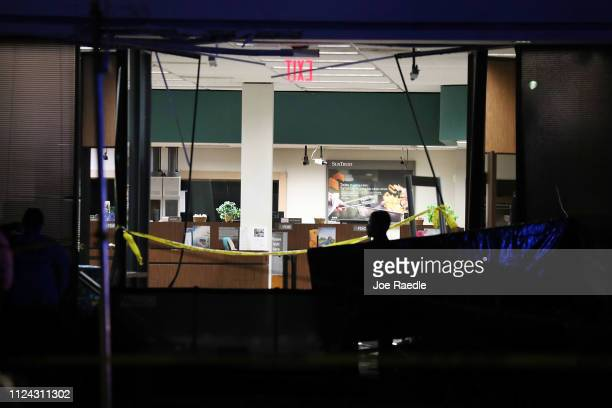 The SunTrust Bank branch is seen as law enforcement officials investigate the scene where five people were killed on January 23 2019 in Sebring...