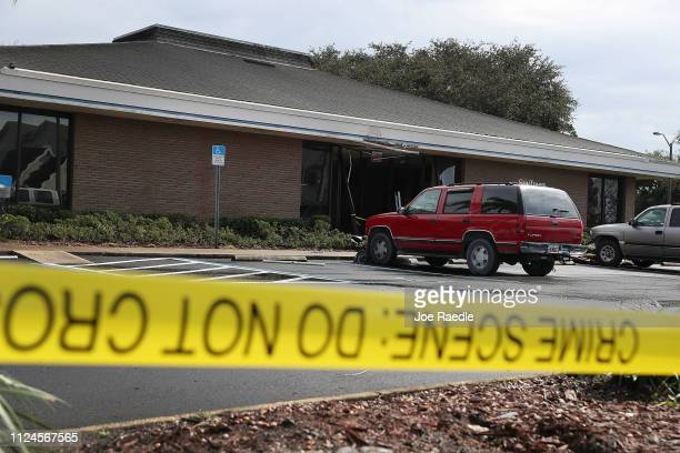The SunTrust Bank branch is seen as law enforcement officials continue to investigate the scene where five people were killed on January 24 2019 in...