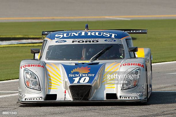The SunTrust Racing Ford/Dallara, driven by Max Angelelli and Brian Friselle, drives on pit road after winning the Rolex Grand-Am Sports Car Series...