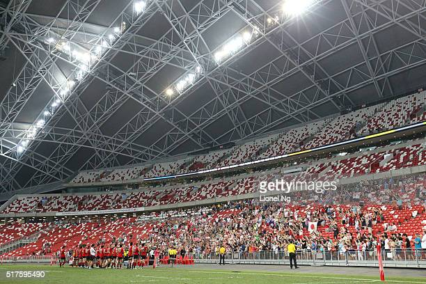 The Sunwolves acknowledge their fans for their support after the round five Super Rugby match between the Sunwolves and the Bulls at Singapore...