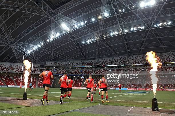 The Sunwolves run onto the pitch before the round 12 Super Rugby match between the Sunwolves and the Stormers at Singapore National Stadium on May 14...