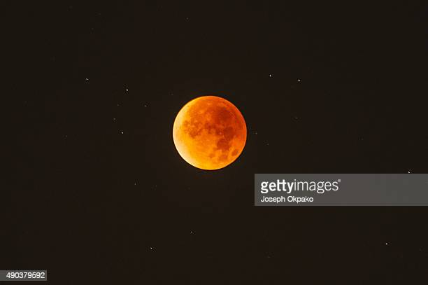 The Super Blood Moon lights up the sky in London on September 28 2015 in London United Kingdom The Super Moon coincides with a total lunar eclipse a...
