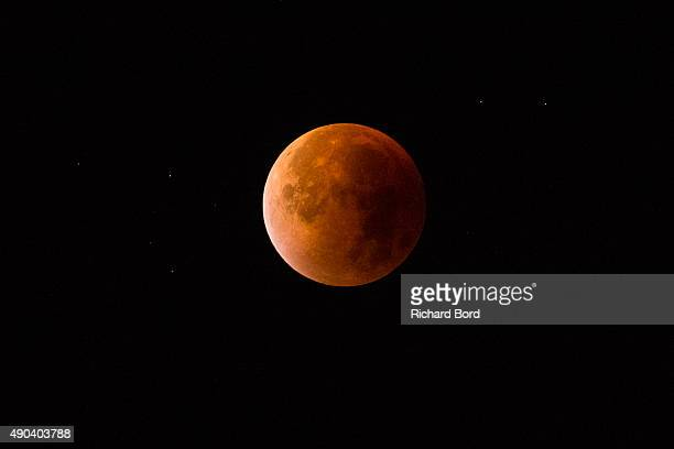 The Super Blood Moon lights up the sky on September 28 2015 in Paris France The Super Moon coincides with a total lunar eclipse a rare combination...
