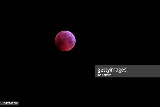 The Super Blood Wolf Moon is visible from Saltburn in North Yorkshire on January 21 2019 in Saltburn England The rare celestial event takes places...