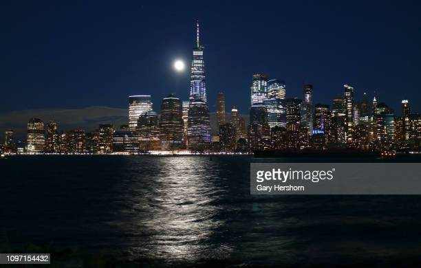 The Super Blood Wolf Moon rises over the skyline of lower Manhattan and One World Trade Center in New York City on January 20 2019 as seen from...