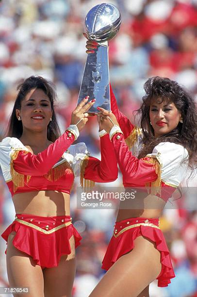 The Super Bowl XIX Trophy is shown off by 49ers Cheerleaders during a celebration honoring Bill Walsh prior to a game between the Atlanta Falcons and...