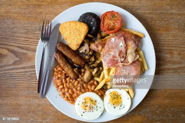 The 'Super' full English breakfast sits at the 'Enough to Feed an Elephant' cafe in this arranged photograph in London, U.K., on Monday, July 10,...