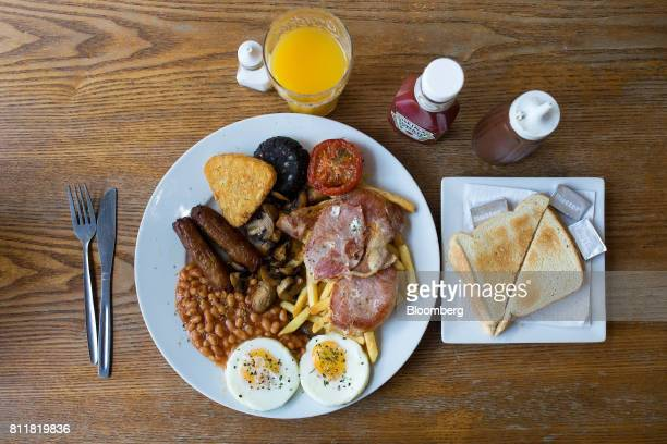 The 'Super' full English breakfast sits at the 'Enough to Feed an Elephant' cafe in this arranged photograph in London UK on Monday July 10 2017...