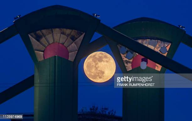 The Super Moon can be seen behind pillars of the Floesserbruecke bridge in Frankfurt am Main western Germany on February 19 2019 / Germany OUT