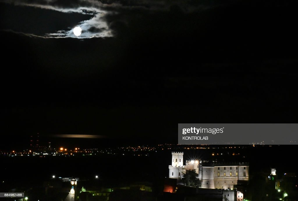 SUPERMOON - The Super moon of 2017, the only moment in 2017 year when the moon looks much bigger. Here it is seem above the Castle of Corigliano, in Calabria, southern Italy.