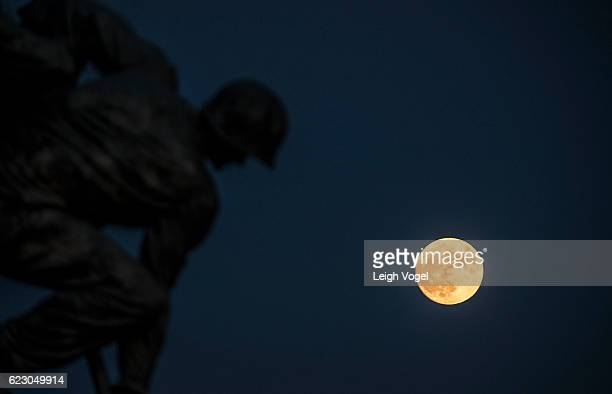 The Super Moon rises behind the United States Marine Corps War Memorial also known as the Iwo Jima Memorial on November 13 2016 in Washington DC