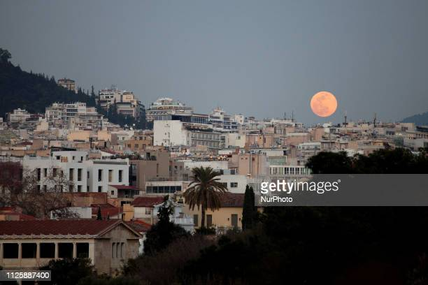 The Super Moon rises in Athens Greece on February 19 2019 A full moon rises in the night sky known as a Snow Moon and the celestial body appears big...
