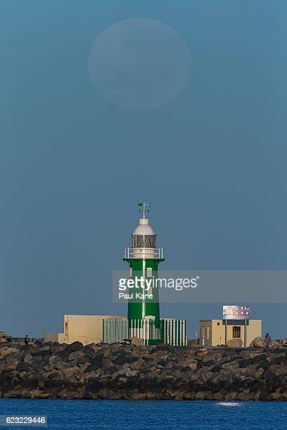 The super moon sets over the Indian Ocean on November 15 2016 in Fremantle Australia A super moon occurs when a full moon passes closes to earth than...