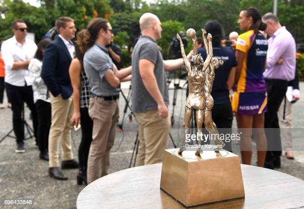 The Super Netball winners trophy is seen as Captain Geva Mentor and Coach Noeline Taurua of the Sunshine Coast Lightning speak to the press during...
