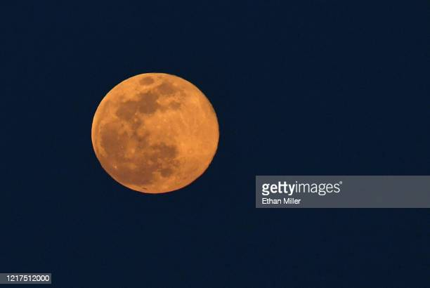 The super pink moon the biggest supermoon of the year is shown shortly after rising on April 7 2020 in Las Vegas Nevada The pink moon got its name...