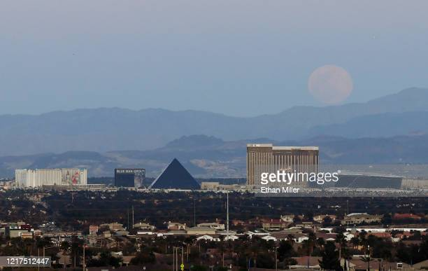 The super pink moon the biggest supermoon of the year rises over Excalibur Hotel Casino Luxor Hotel and Casino Delano Las Vegas at Mandalay Bay...