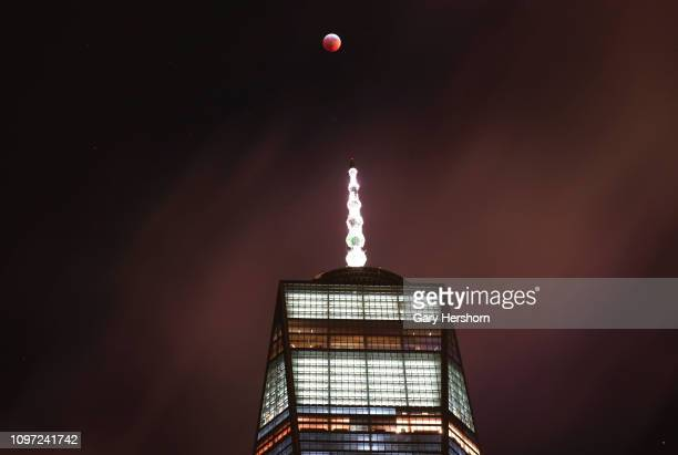 The Super Wolf Blood Moon lunar eclipse passees over One World Trade Center on January 20 2019 in New York City Photo by Gary Hershorn/Getty Image