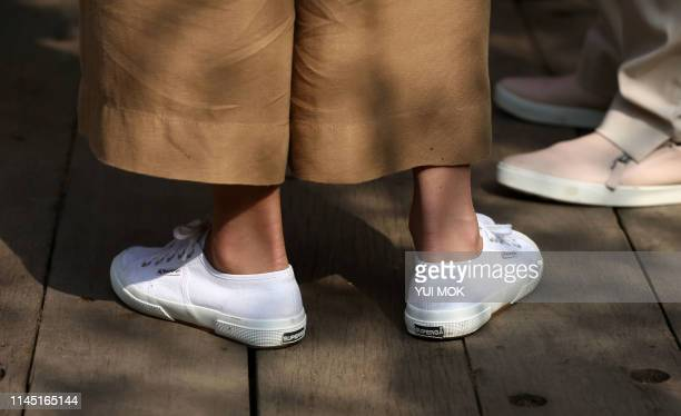 The Superga footwear worn by Britain's Catherine Duchess of Cambridge is pictured during her visit to the 2019 RHS Chelsea Flower Show in London on...