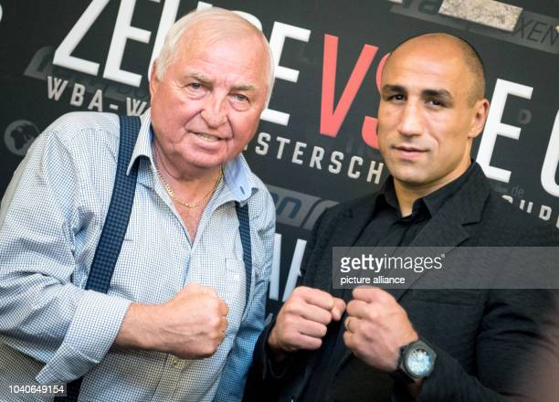 The SuperMiddleWeight Boxer Arthur Abraham with his coach Ulli Wegner after a press conference in Berlin Germany 01 June 2016 Abraham and Norwegian...