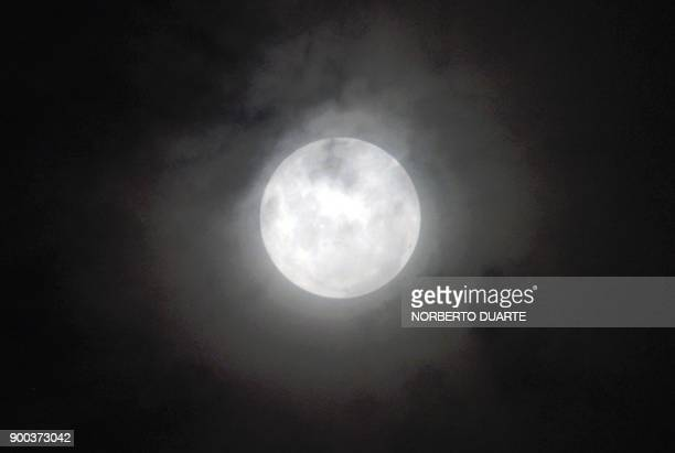 The 'supermoon' is pictured rising over Asuncion on January 1 2018 Supermoons happen when a full moon approximately coincides with the moon's perigee...
