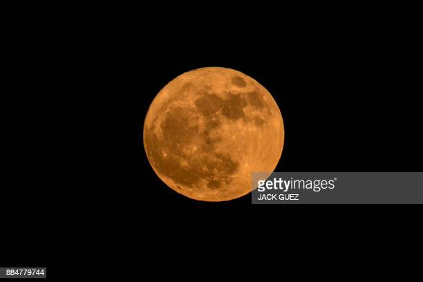 The 'supermoon' is seen in the Israeli city of Netanya on December 3 2017 The lunar phenomenon occurs when a full moon is at its closest point to...
